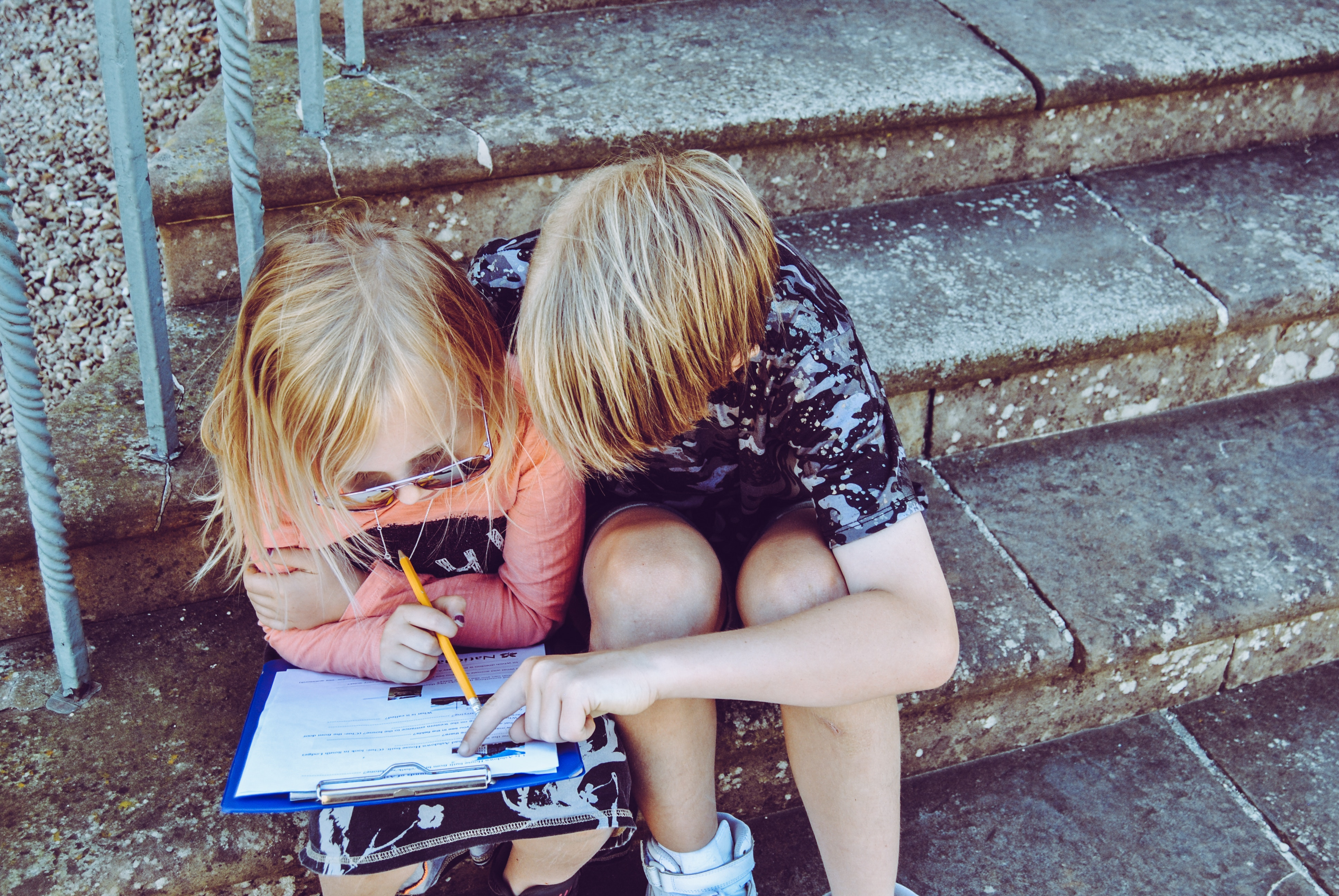 Children looking at list - Giant List Of Family Activities For A No-Spend Weekend