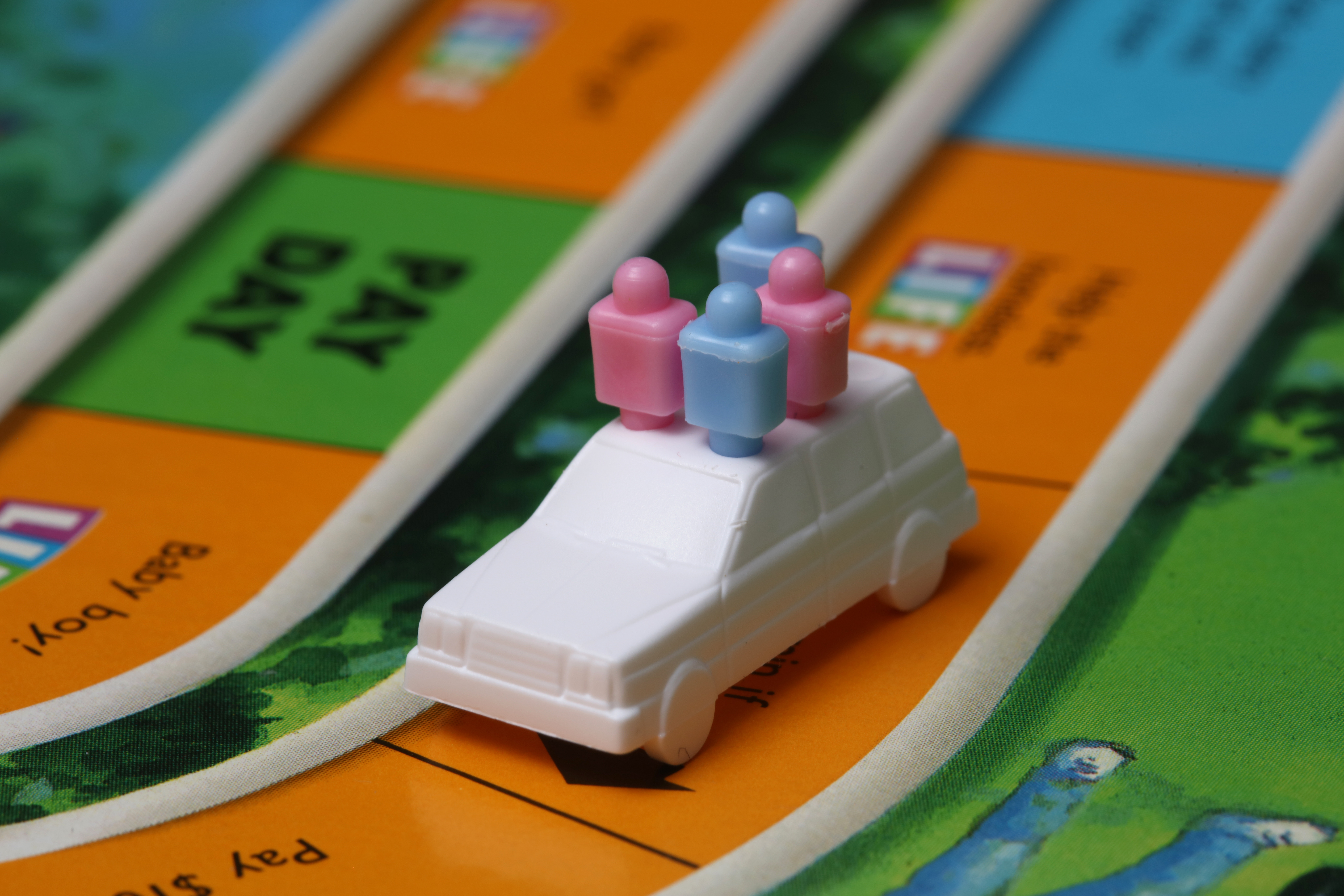 Plastic car on game board - Giant List Of Family Activities For A No-Spend Weekend