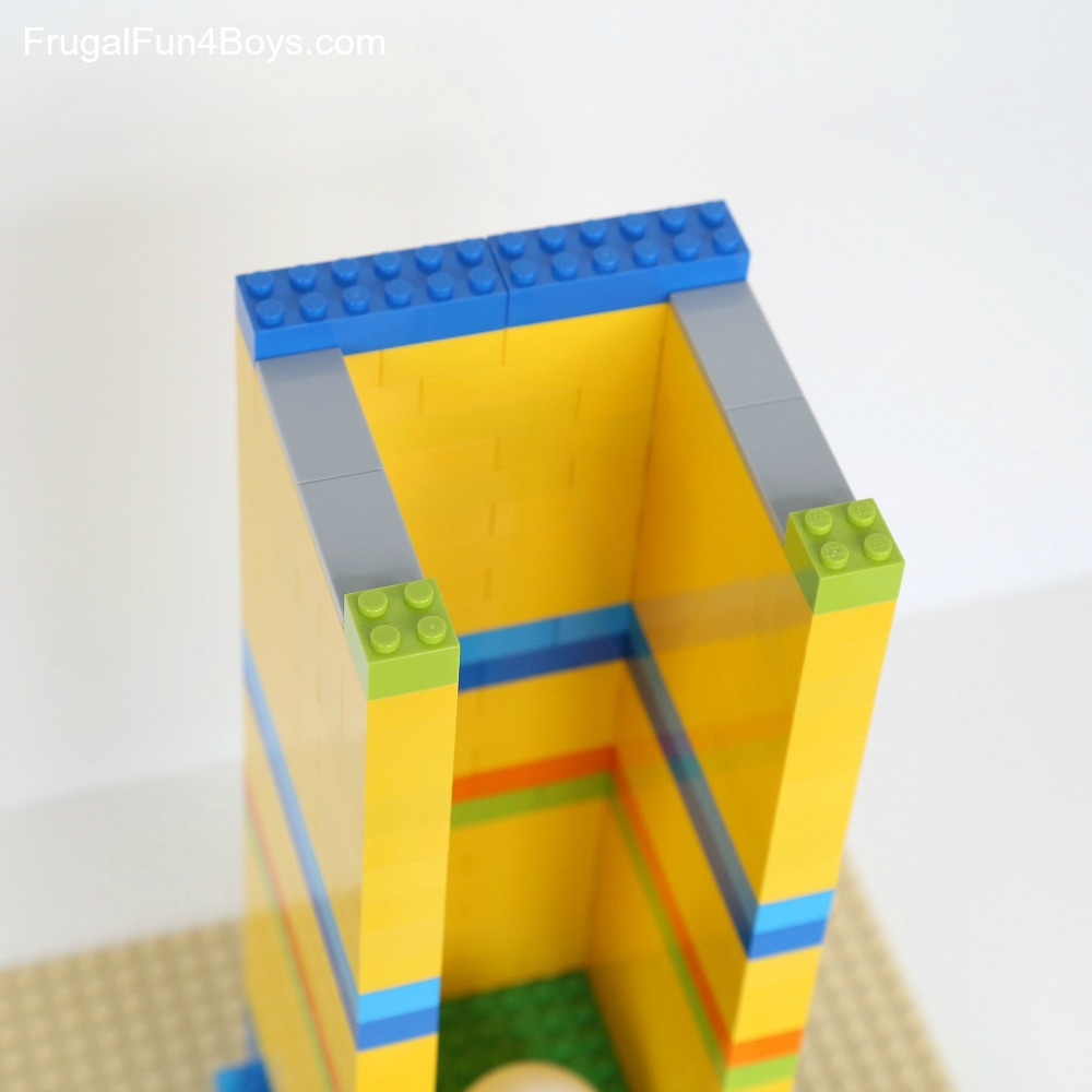 Build a New Year s Eve Ball Drop with LEGO Bricks     Frugal Fun For     Here s what the top of the tower looks like  We put two 2 x 4 tiles on each  side to make a slot for the ball tray to slide through