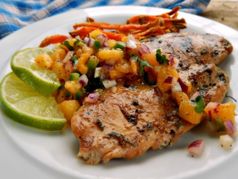 Jerk Chicken Breasts, shown here with Pineapple Mango Salsa and Sweet Potato Fries