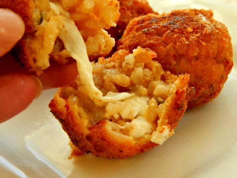 Arancini: breaded and fried balls of risotto stuffed with cheese!