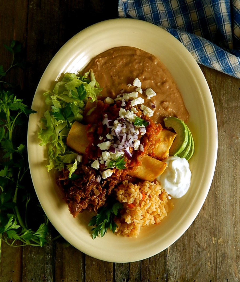 Three Cheese Enchiladas with Braised Pork & Ranchero Sauce