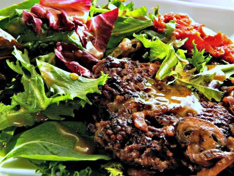 Sweet Sorghum Vinaigrette Drizzled over Smashburger in Taphouse Salad