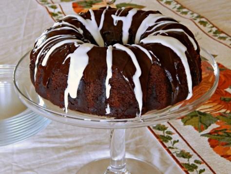 Chocolate Banana Bundt Cake with a Rum Spiked Cream Cheese, Chocolate Chip Tunnel, Chocolate Ganache & Vanilla Rum Glazes
