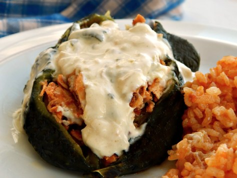 Chipotle Chicken Stuffed Poblanos with Creamy Rajas Sauce