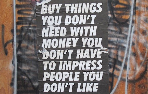 Buy things you don't need with money you don't have to impress
