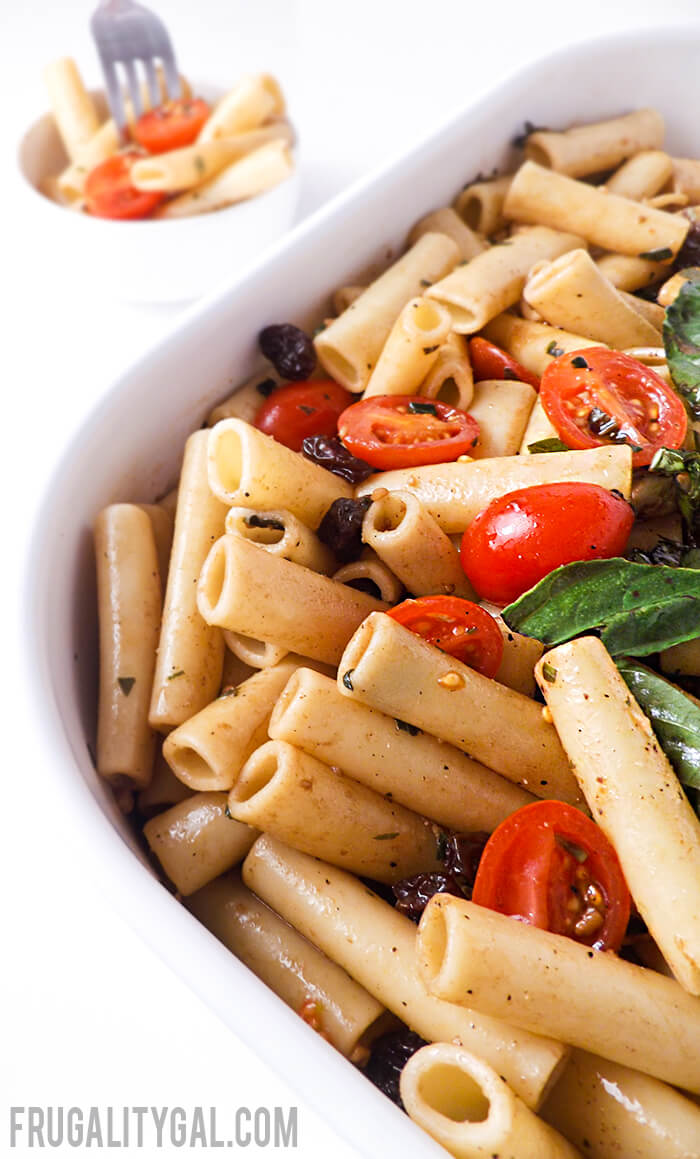 Caprese Pasta Salad Recipe. A quick and tasty summer recipe for a crowd or just an easy dinner to toss together on a busy night!