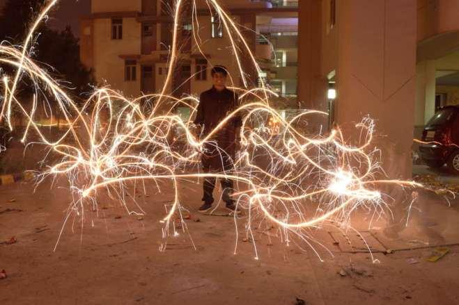 Bro with firecrackers around.