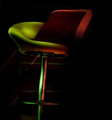 Light painting my stool with a pillow on it.