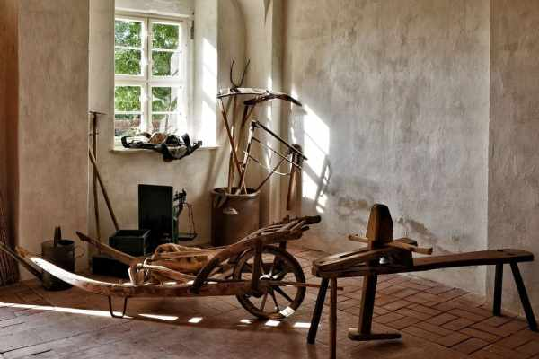 A room containing an assortment of vintage farm equipment