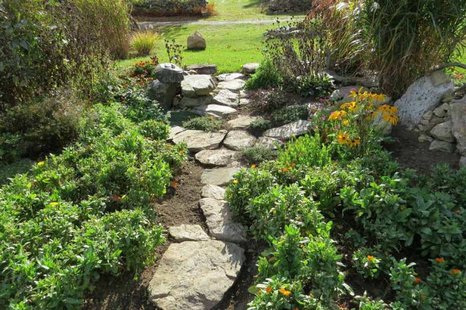 A garden path protects rich topsoil.