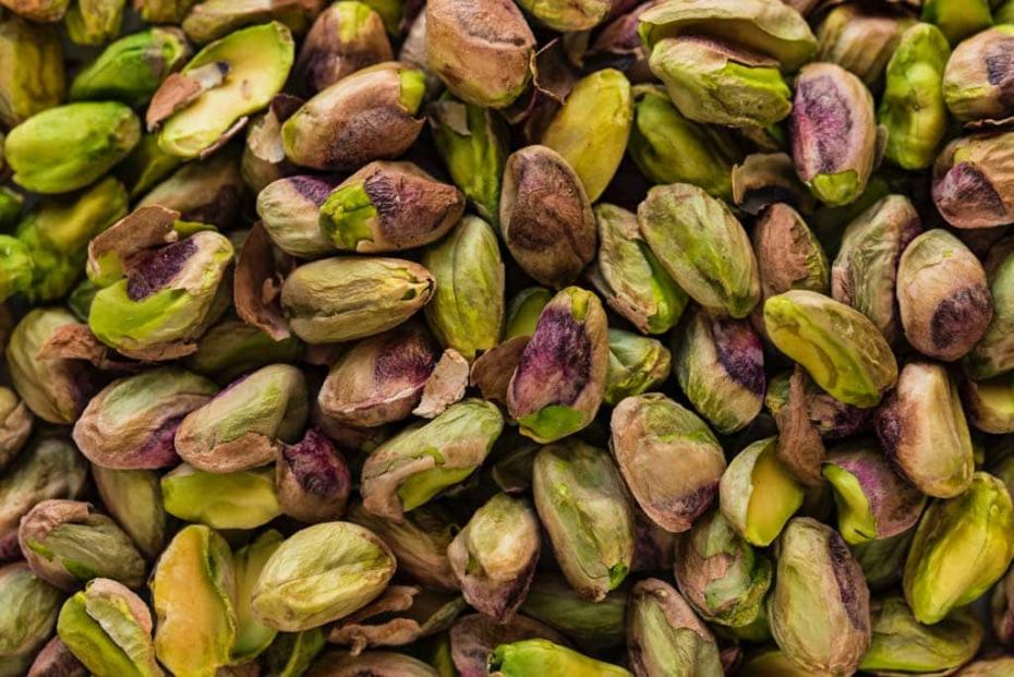 Pistachio growing produces delicious purple and green nuts.