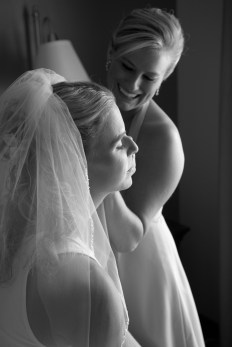 maid of honor and bride getting ready in hotel room