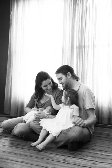 black and white family portraits in home with newborn