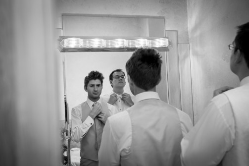 groom and best man getting ready before wedding
