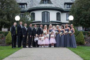bridal party in pink and gray in front of Mansion at Linden Hall