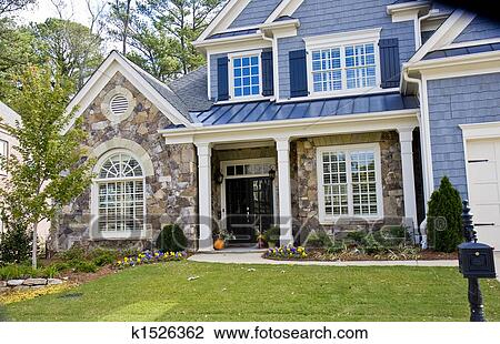 Stock Photo of Stone and Blue House k1526362 - Search ... (450 x 310 Pixel)