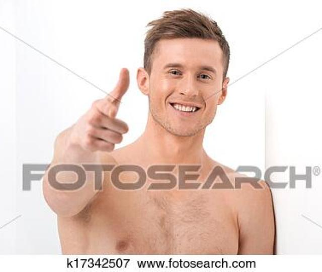 Close Up Of Sexy Handsome Naked Man Smiling On Camera Pointing With Finger On Camera While Isolated Over White Background