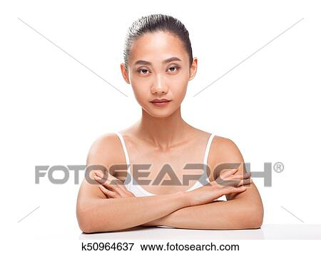 Beautiful Asian Model With Perfect Tanned Skin And Beauty Face Young Woman Looking Camera Studio Portrait Isolated On White Background