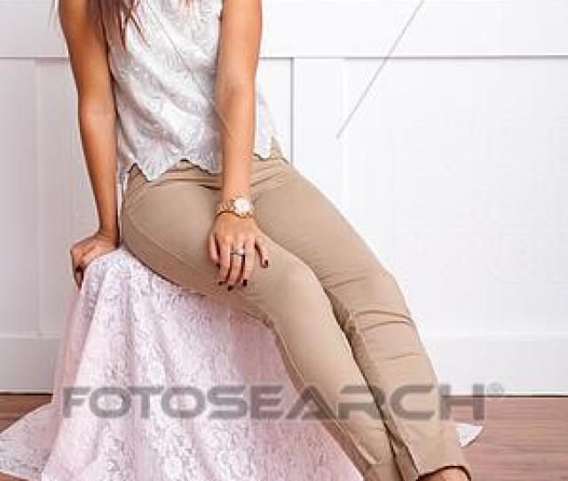 Picture Teen Sits With Legs Stretched Out Fotosearch Search Stock Photos Images