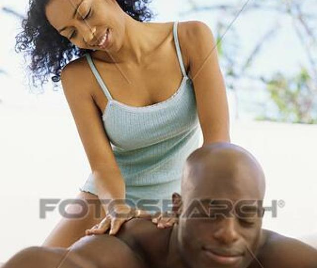 Mid Adult Woman Giving A Back Massage To A Man