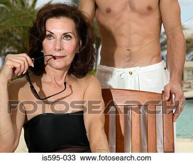 Mature Woman And Young Man On Vacation