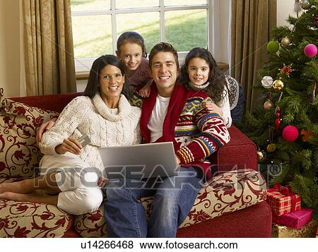 Hispanic Family Christmas Shopping Online Stock Photo U14266468 Fotosearch