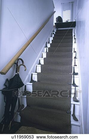Umbrellas And Collection Of Old Iron Shoe Lasts On Steep White   White Stairs With Grey Carpet   Top   Laminate Flooring Carpet   White Staircase   Grey Stripe   Dark Grey