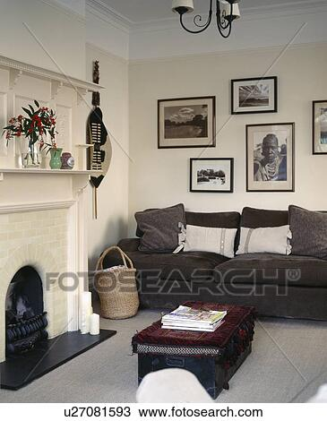 Black White African Photographs Above Dark Grey Sofa In Cream Living Room Stock Image U27081593 Fotosearch