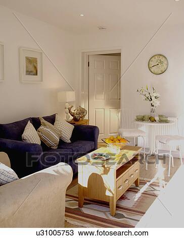 cream cushions on purple sofa in modern