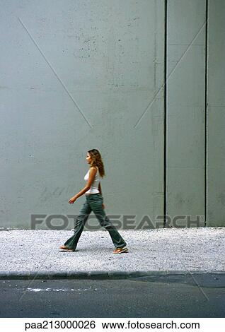 Stock Images Of Woman Walking On Sidewalk Side View