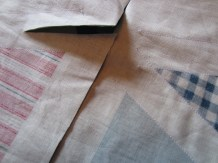 Stitching the bunting before cutting