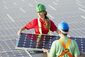 Electricians installing solar panels
