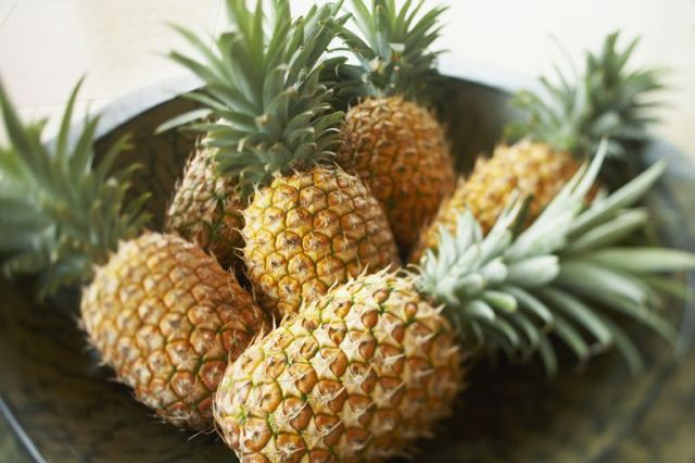 Bowl of Large, Ripe Pineapples