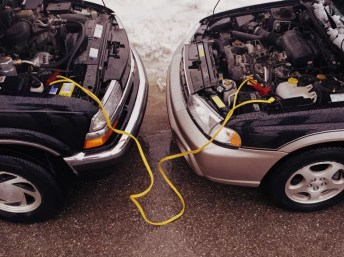 in case of a dead battery, two vehicles and jumper cables come together to get the engine going
