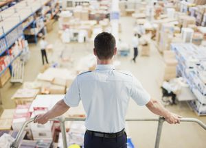 Man overlooking warehouse
