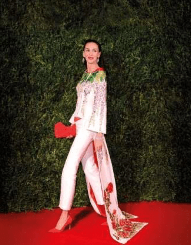 L'Wren Scott wearing a couture embroidered kimono tailcoat of her own design, from the 'Tagasode' collection, Spring-Summer 2014. Estimate £2,000-3,000 © David Fisher/Shutterstock
