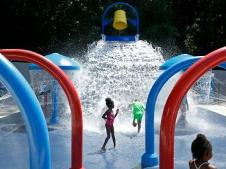 Kids play at Adams Park Splash Pad was funded in part by Carnival Cruise Lines