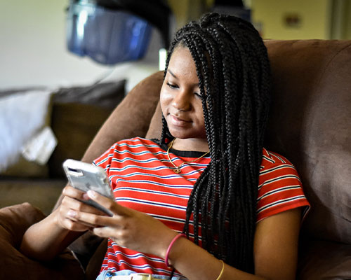 High school girl on cell phone