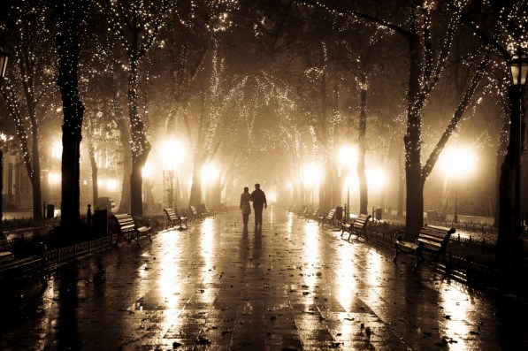 Couple walking in night lights.