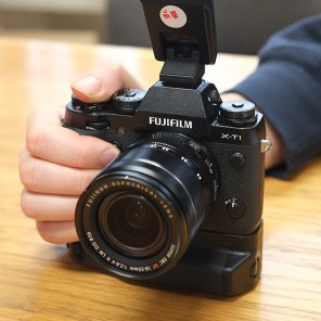 Fujifilm X-T1 with vertical grip and supplied EF-X8 flash