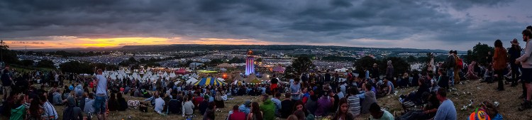 The sun sets over the festival site on the first evening of Glastonbury 2015. June 24 2015.