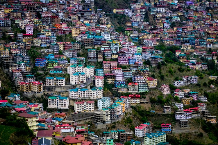 Shimla, Himachal Pradesh, India. Housing on the hillside around Shimla. The town, built on seven hills, was the summer capital of British India, becoming the capital of Himachal Pradesh after independence.