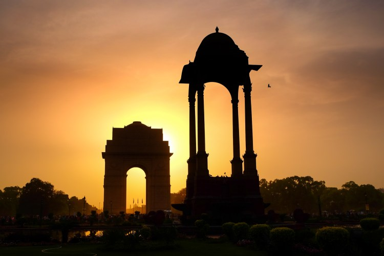Delhi, India. India Gate at sunset, The 42 m high archway stands in the center of New Delhi and commemorates the 70,000 Indian soldiers who lost their lives fighting for the British Army during World War 1. It also bears the names of British and Indian soldiers killed in the Afghan war of 1919. The structure sits in a large expanse of green lawns which are popular for picnics and cricket on summer evenings.