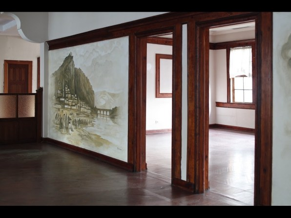 Historically preserved wall mural in upstairs loft