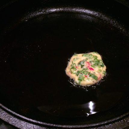 Cooking Ramp Fritter in a Cast Iron Skillet