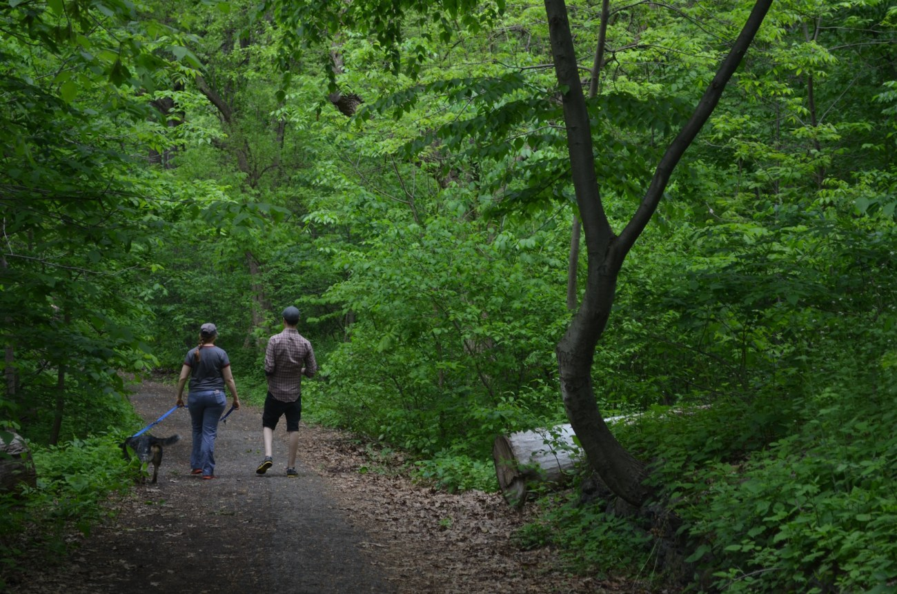 Couple Walking in Inwood Hill Park in Manhattan