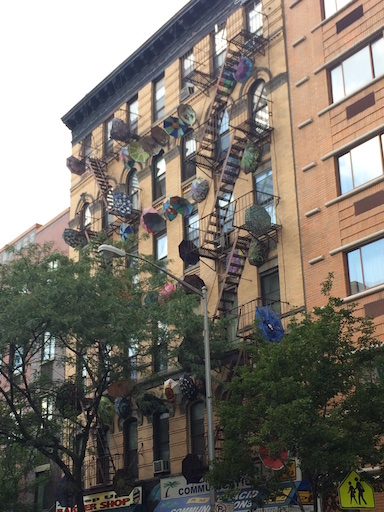 Umbrellas Adorning New York City Apartment Building