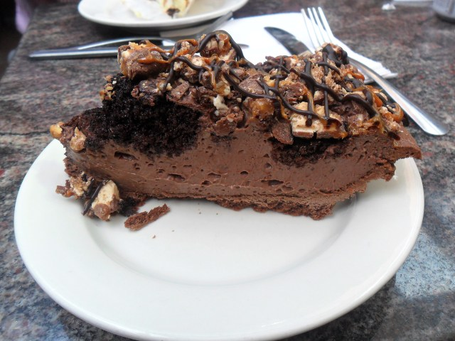 chocca rocca pie: pie crust with chocolate mousse, chocolate cake and crushed snickers and reeses pieces.