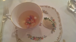 Tomato consomme, cucumber and rosary goat's cheese dumplings